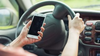 Call to ban mobile phones in cars